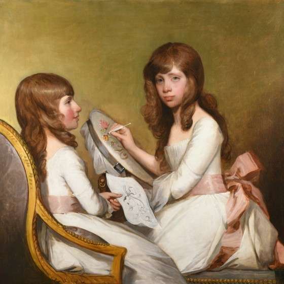 Two seemingly identical people in white dresses with a pink bow doing needlepoint.