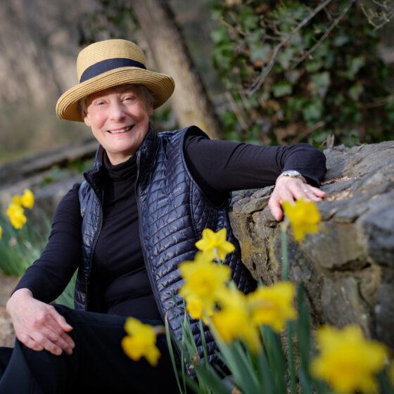 Wake Forest professor emeritus of art history Margaret (Peggy) Smith poses for a portrait on the walkways near Reynolda House.